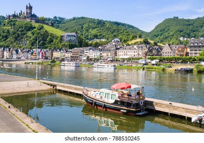 COCHEM, GERMANY - JUNE 28, 2010: boats in Moselle river near Cochem city with Reichsburg Cochem castle in summer day. Cochem is the biggest town in the Cochem-Zell district in Rhineland-Palatinate