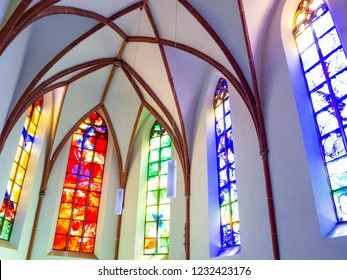 COCHEM, GERMANY - MAY 05, 2013: Colorful stained glass windows in the choir of Saint Martin's Catholic Parish Church at Cochem, Rhineland-Palatinate, Germany