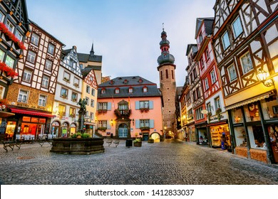 Cochem, Germany - October 08 2018: Colorful half-timbered houses in historical medieval Old Town of Cochem are a popular tourist attraction in Moselle river valley, Germany