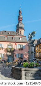 COCHEM, GERMANY, OCTOBER 2018 - Ancient Town Hall building in the old town market square, Cochem, Germany, with St Martin's water fountain in the foreground