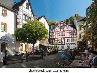 COCHEM, GERMANY, OCTOBER 2018 - A busy town square in the city of Cochem, Germany with people sitting outside bars and cafes