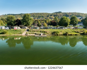 COCHEM, GERMANY, OCTOBER 2018 - Caravans on a camp site on the banks of the Moselle river at Cochem, Germany