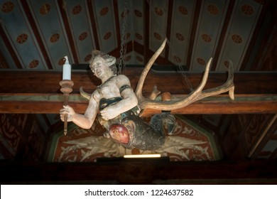 COCHEM, GERMANY, OCTOBER 2018 - Mermaid chandelier in Cochem Castle. Supposedly you can rub its tummy and make a wish