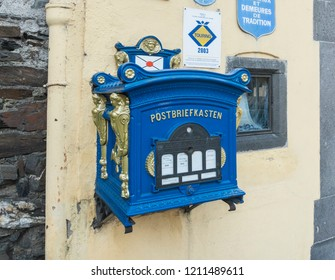 COCHEM, GERMANY, OCTOBER 2018 - Ornate vintage post box in the town of Cochem, Germany