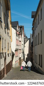 COCHEM, GERMANY, OCTOBER 2018 - Street view of Cochem, Germany with an elderly couple walking, holding hands