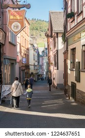 COCHEM, GERMANY, OCTOBER 2018 - Street view of Cochem, Germany with an woman and boy walking, holding hands