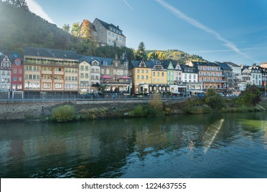COCHEM, GERMANY, OCTOBER 2018 - view of the city of Cochem, Germany from the Moselle River, with sun flare