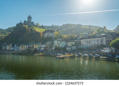 COCHEM, GERMANY, OCTOBER 2018 - view of the city of Cochem and castle, Germany from the Moselle River, with sun flare