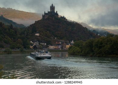 COCHEM, GERMANY - OCTOBER 5, 2018: Inland navigation vessel passing Cochem on the Moselle river on October 5, 2018 in Germany, Europe
