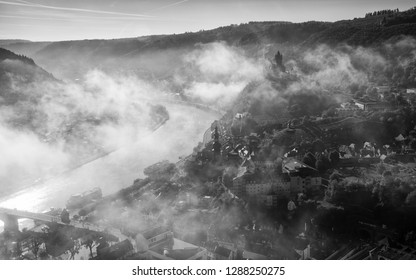 COCHEM, GERMANY - OCTOBER 5, 2018: Panoramic image of the city of Cochem close to the Moselle river on a foggy autumnal morning on October 5, 2018 in Germany, Europe