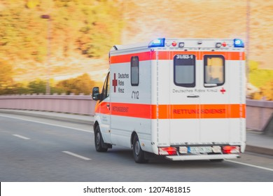 COCHEM, GERMANY - SEPTEMBER 15 2018: Ambulance drives urgently through Cochem on the way to a patient early in the morning