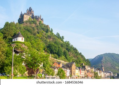 Cochem, Rhineland-Palatinate / Germany - 05.26.2019: Cochem and the river Moselle on a sunny May day. In the background on a hill the Reichsburg Cochem.