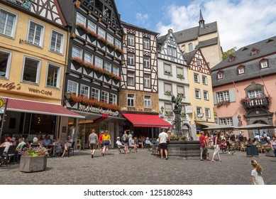 Cochem/Germany, July 26, 2018 Market square with open-air cafes and a nice fountain, the town of Cochem, the Moselle Valley.