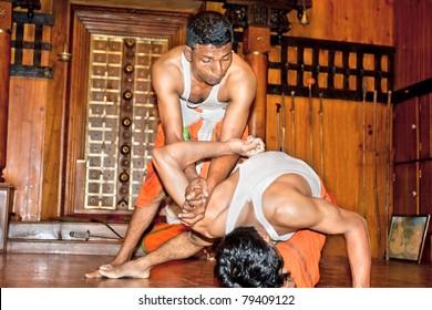 COCHIN - FEBRUARY 16: Kalaripayattu master demonstrates his skills on the evening show on February 16, 2009 in Fort Cochin, South India. Kalaripayattu is the ancient martial art of Kerala.