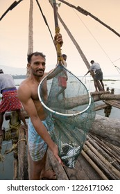 Cochin. India. 11.04.06. Fishermen and Chinese fishing nets at dawn in the Fort Kochi area of Cochin in the Kerala region of southern India.