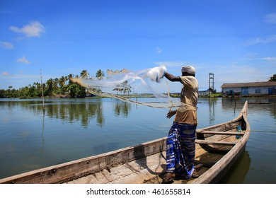 COCHIN, INDIA - JUL 28 : Unidentified villager throws the fishing net in to the backwaters on July 28, 2016 in Cochin,Kerala, India. Fishing is major job of people living in the backwater region.