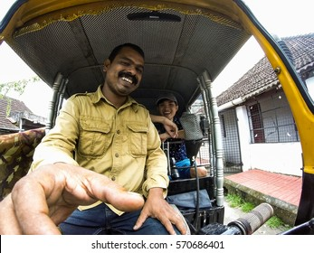 COCHIN, INDIA - JULY 25, 2016: the tourist taking selfie with a tuk tuk driver in india. taken by gopro