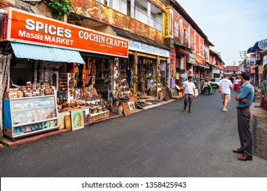 COCHIN, INDIA - MARCH 14, 2012: Market street with souvenir and spice shops in Fort Kochi in Cochin city, India
