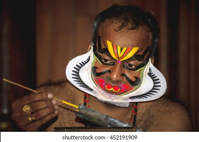 COCHIN, INDIA - NOVEMBER 23, 2015: Performer making up before the traditional kathakali dance of Kerala's state in India.