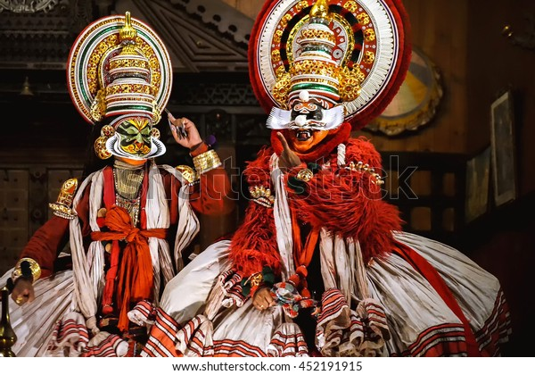 COCHIN, INDIA - NOVEMBER 23, 2015: Two unidentified kathakali performers during the traditional kathakali dance of Kerala's state in India.