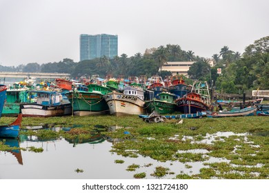 COCHIN, KERALA, INDIA - NOVEMBER 1, 2018: A fleet of fishing boats sit idle by the banks of Willingdon Island, just across the water from Cochin (Kochi), in the southern Indian state of Kerala.