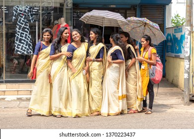 COCHIN, KERALA, INDIA - NOVEMBER 1, 2018: A group of pretty young ladies, all in similar traditional Indian dress, pose for the camera in a street in Cochin (Kochi), in the southern state of Kerala.