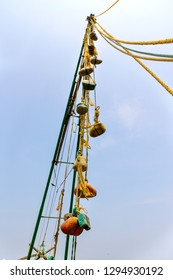 COCHIN, KERALA, INDIA - OCTOBER 31, 2018: Rocks strung together with rope form the counterbalance of the ingenious Chinese fishing nets, seen here at Cochin in the southern Indian state of Kerala.
