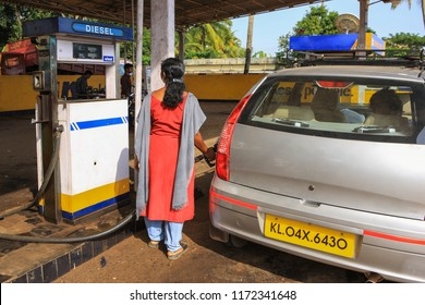 Cochin,December,20,2008:Well dressed female worker at petrol pump filling  diesel oil in taxi from Cochin ,Kerala, India,Asia