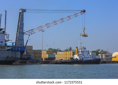 Cochin,December,23,2008: Loading and unloading of containers on ships by cranes for Export,import through shipping transport at Cochin port ,Kerala,India