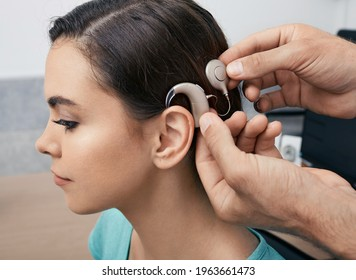 Cochlear implant. Installation cochlear implant on woman's ear for restores hearing