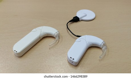 Cochlear implantation and hearing aid for deaf people to restore hearing