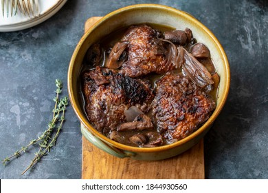 Cock au vin, French dish of chicken braised in wine