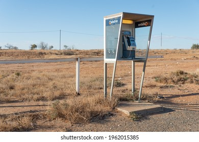 Cockburn, Australia - Apr 23, 2021: Telstra pay phone emergency telecommunication in remote town in South Australia