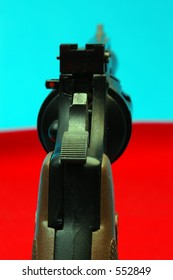 a cocked revolver handgun with the focus on the hammer