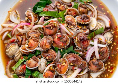 Cockle Salad,Cockles salad / Hot and spicy shellfish blood cockles salad mix vegetable tomato herb and spices thai style food