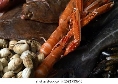 Cockles and king prawns on display at fishmongers