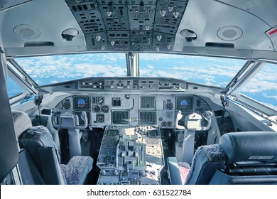 Cockpit of the airplane with sky view through a windshield