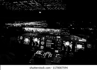 Cockpit of a Jumbo Jet Freighter overhead NYC (lights in the background - out of focus)