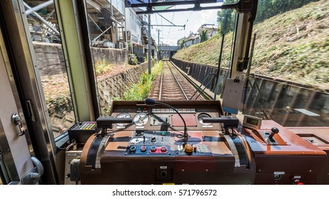 Cockpit of a Public Japanese Train Railway with dashboard.