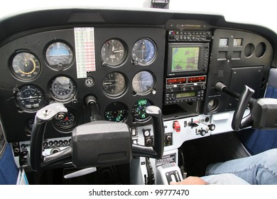 Cockpit of a small aircraft with the instrument panel and steering columns