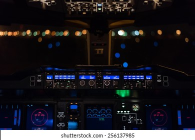 Cockpit view of commercial aircraft.