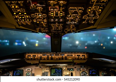 Cockpit view of commercial aircraft. Selective focus on central console