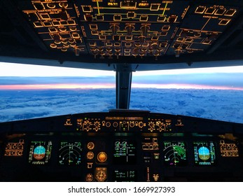 Cockpit view during a early morning flight over the alps