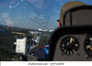 Cockpit view during the towing start with a motor plane of a soaring glider flight over Donauwörth in Bavaria, Gemany