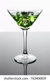 Cocktail absinthe with vodka in martini glass print print for skinned kitchen background interior bar products home furnishings trendy design black gray gradient sliced fruits and ice.