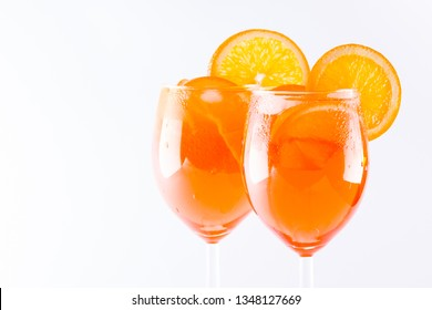Cocktail aperol spritz on white background. Summer alcoholic cocktail with orange slices. Italian cocktail aperol spritz on white. Isolated