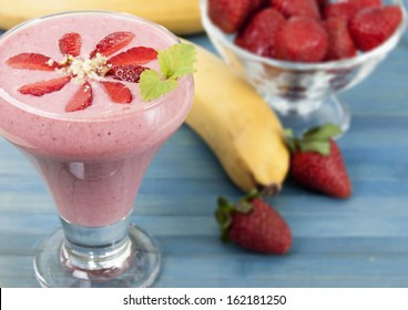 Cocktail of banana with strawberries and yogurt.