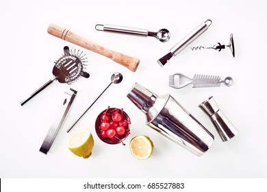 Cocktail Bar utensils with lemon and cherries isolated against white background
