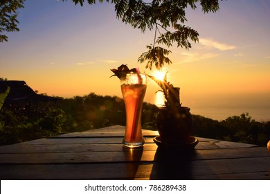 Cocktail with beautiful sunset on sea,landscape nature with sunset background