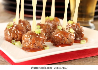Cocktail beef meatballs in sweet and sour sauce.